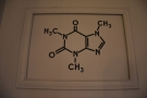 There's a complex chemical formula (caffeine) above...
