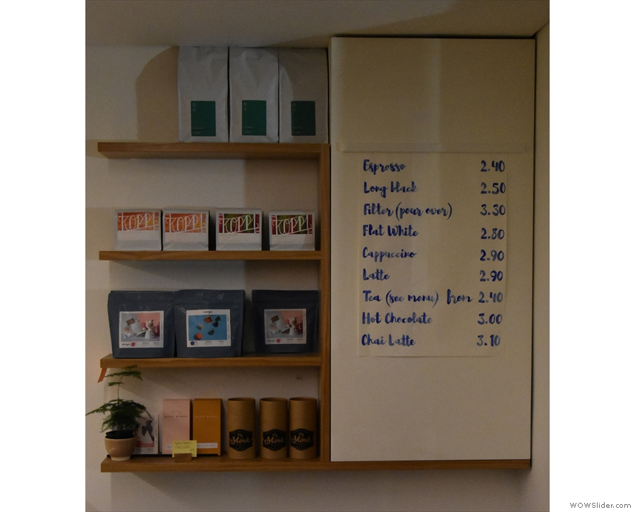 Meanwhile, on the right-hand wall next to the door, is the simple coffee menu...