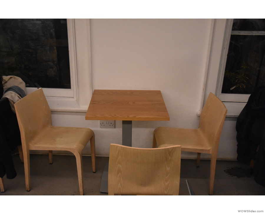 ... and one of the three-person tables against the front wall.