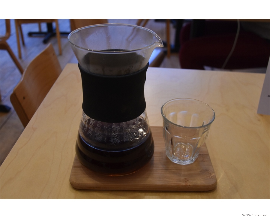 My coffee was served in the carafe, a glass on the side, all presented on a wooden tray.