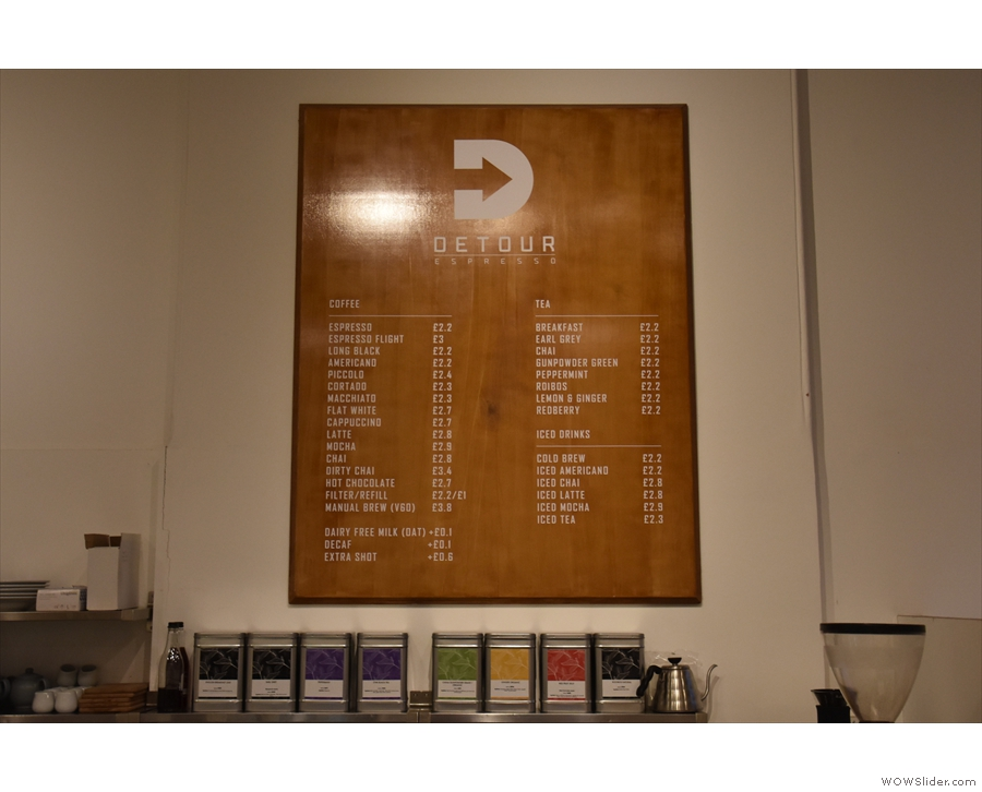 The drinks menu, meanwhile, is on the wall behind the counter...