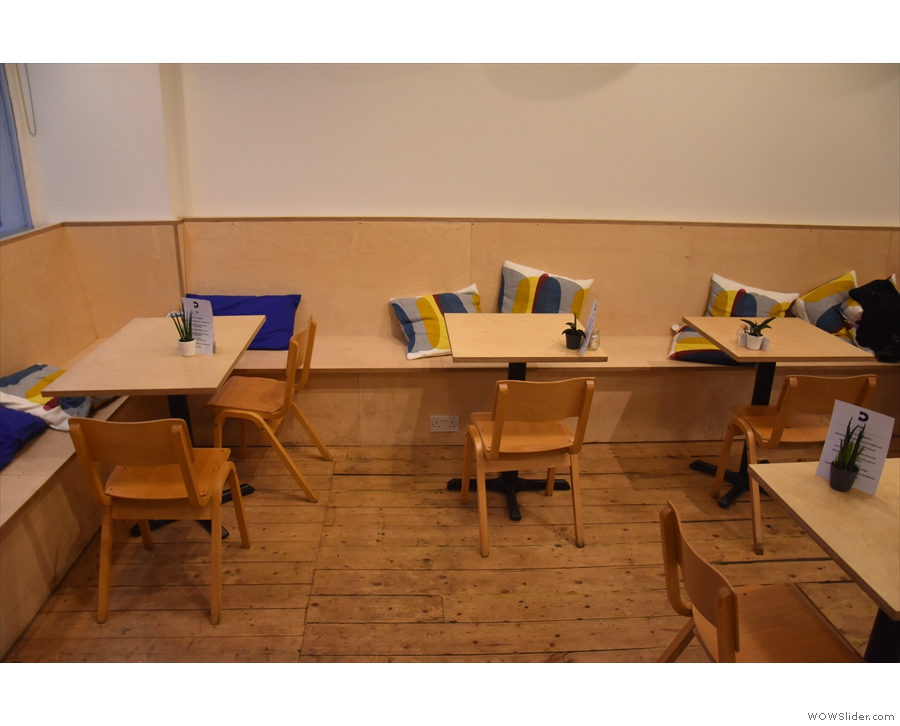 ... followed by a row of two-person tables along the left-hand wall...