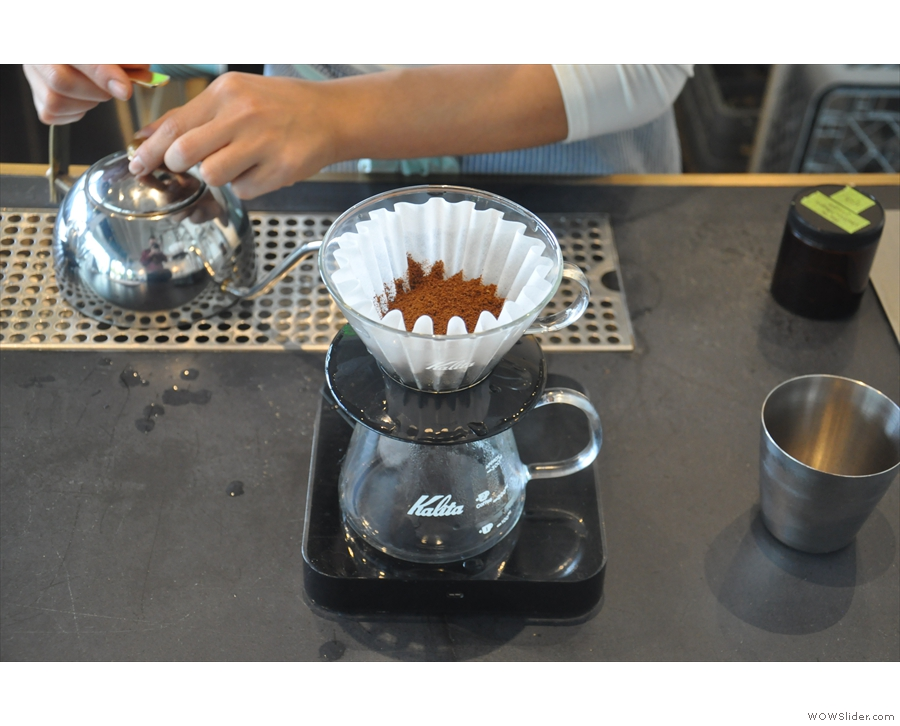 The coffee is then ground and placed in the filter paper...