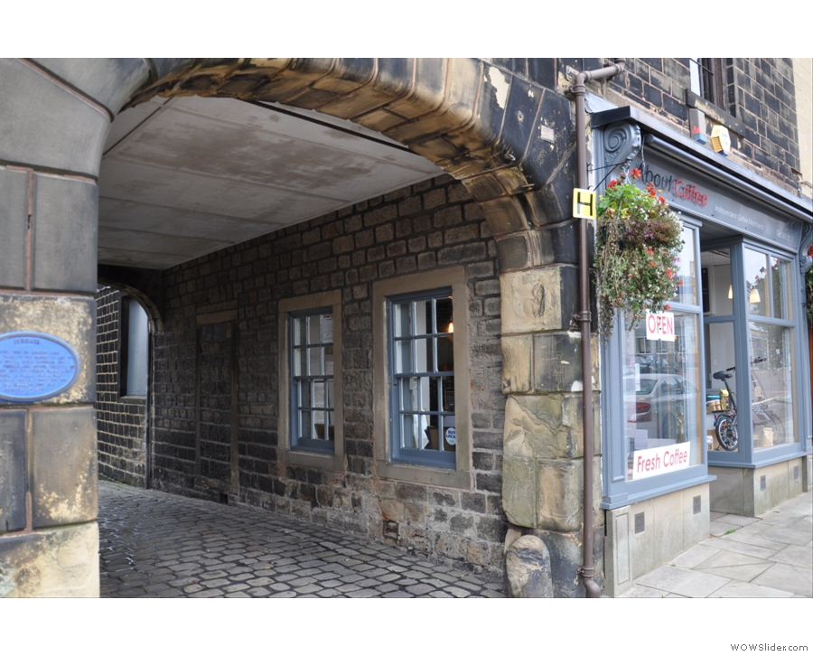 About Coffee is actually at the top of the ancient Ivegate which goes away under the arch.