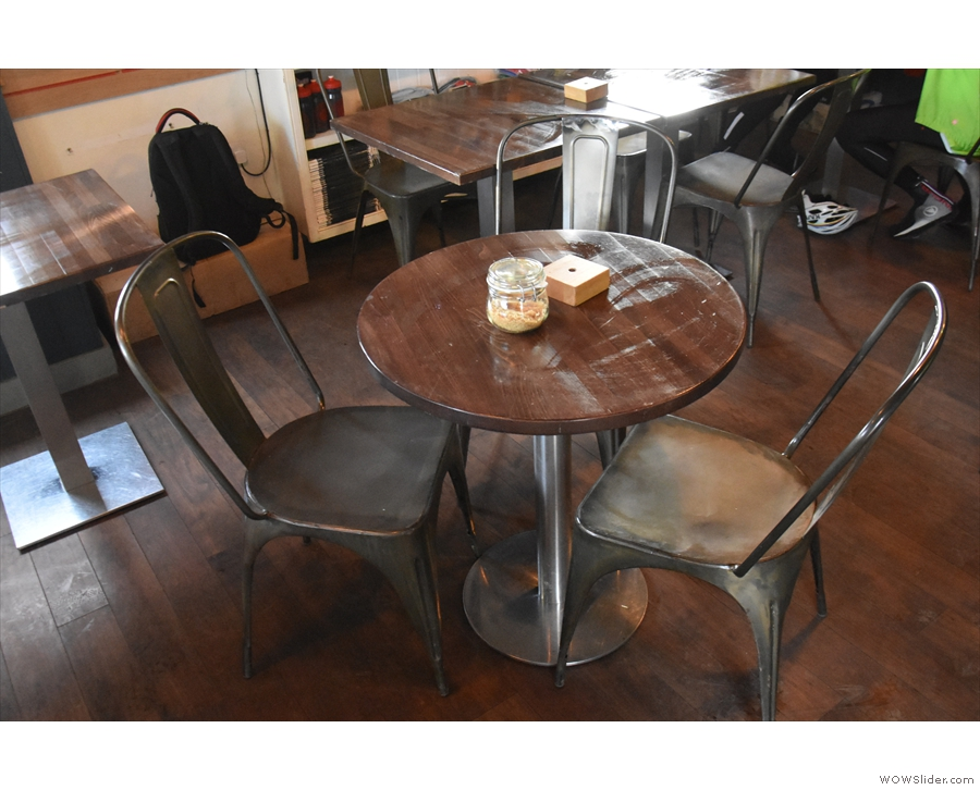 Finally, there's a pair of round, three-person tables like this one in the middle.