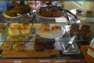... and the cakes on the right, with an open kitchen behind the counter...