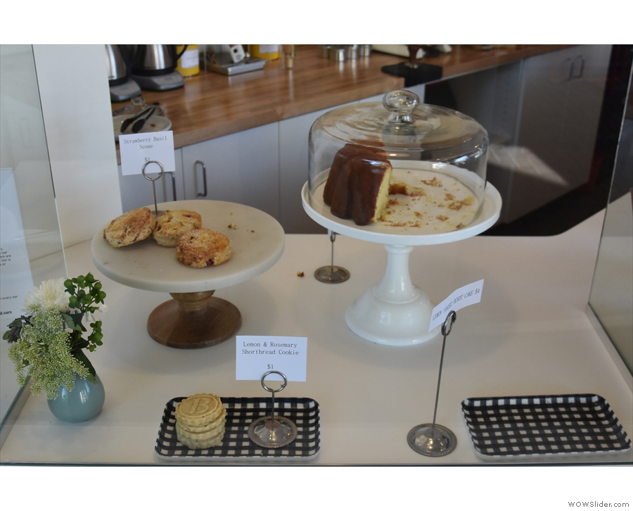 There is a selection of cake just to the left of the till, ahead of you as you enter...