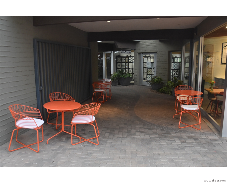 They are a combination of two/three person tables, all in matching orange.