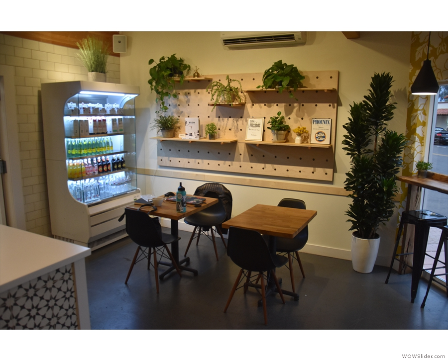 The fridge has moved to the back corner, where you'll also find a pair of tables...
