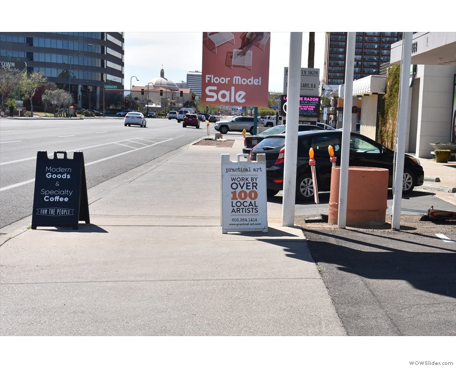 The A-board is right by the side of the road to catch the attention of passing motorists.