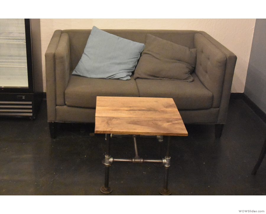 A two-person table at the back is flanked by this two-person sofa on the left...