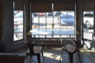One of the best seats in the house is the two-person table in the window-bay...