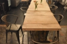 This has a central table (made up of three two-person tables)...