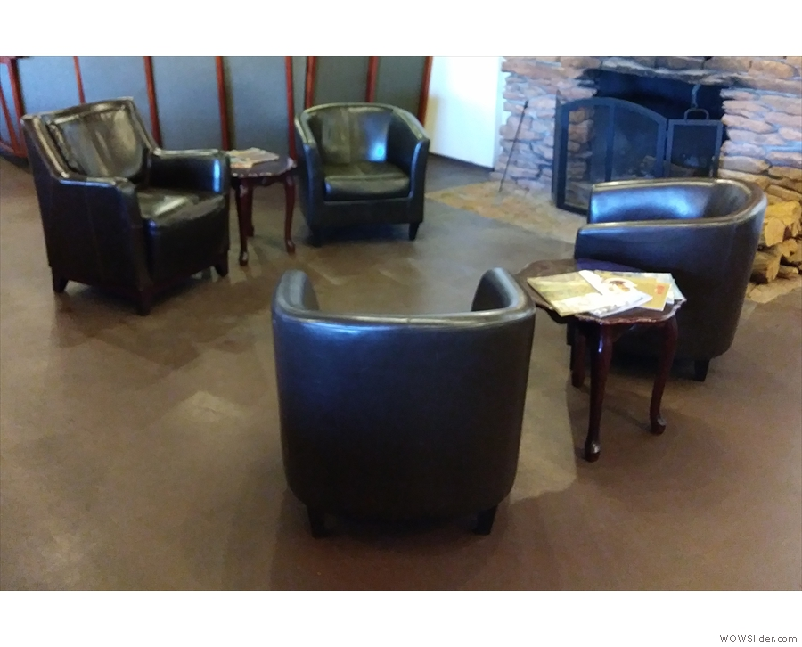Another view of the four armchairs, each pair with its own coffee table.
