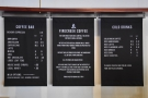The menu is handily placed on the wall behind the counter...