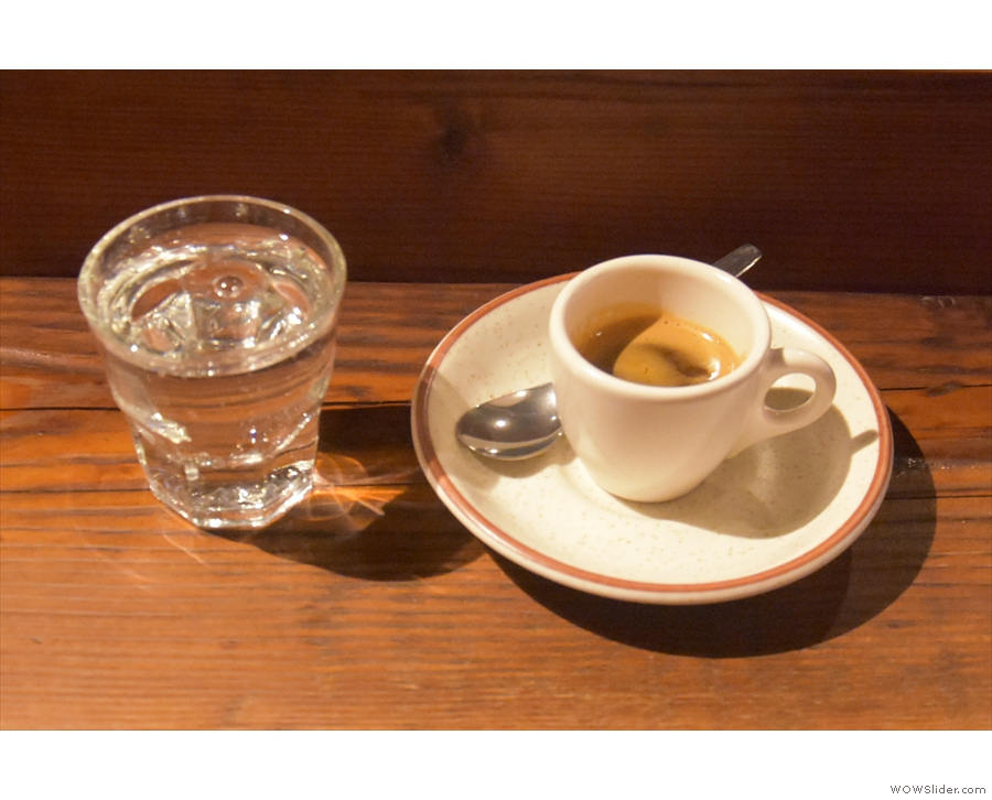 On my return in 2019, I had a Burundi espresso, served with a glass of sparkling water.