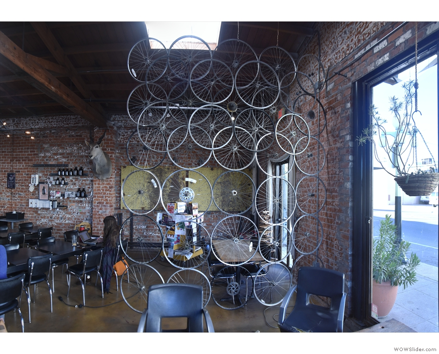 There's more seating beyond this transparent wall of bicycle wheels.