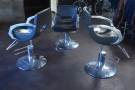 ... and this strange arrangement of three barber-style chairs in the centre.