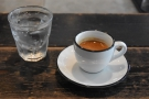 My espresso, served with a glass of sparkling water...