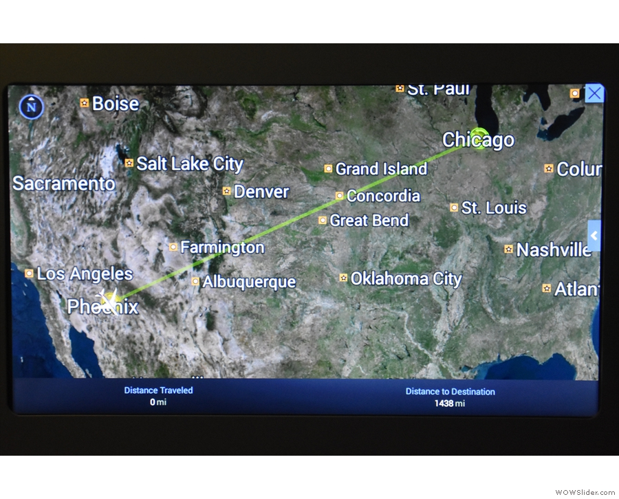 Our flight: Phoenix to Chicago, a mere 1,438 miles, which is roughly...