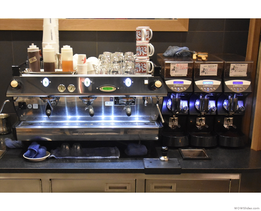 ... while the espresso machine and its three grinders are off to the right.
