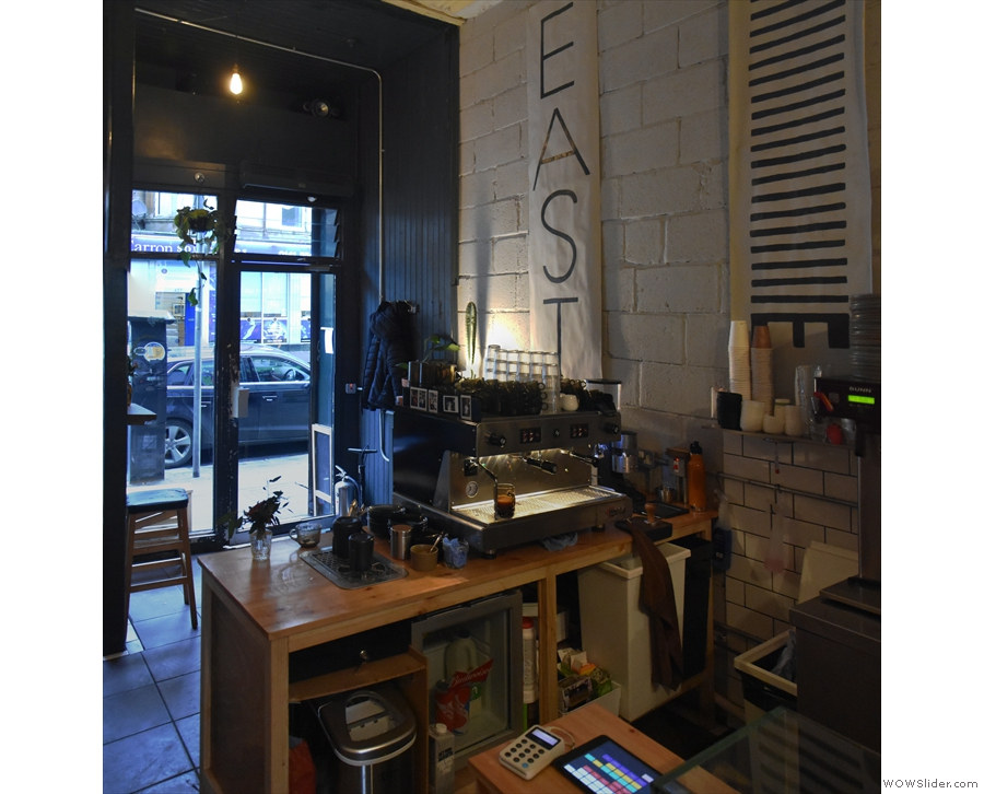 Sit towards the back & you get a good view of the business end of the espresso machine.