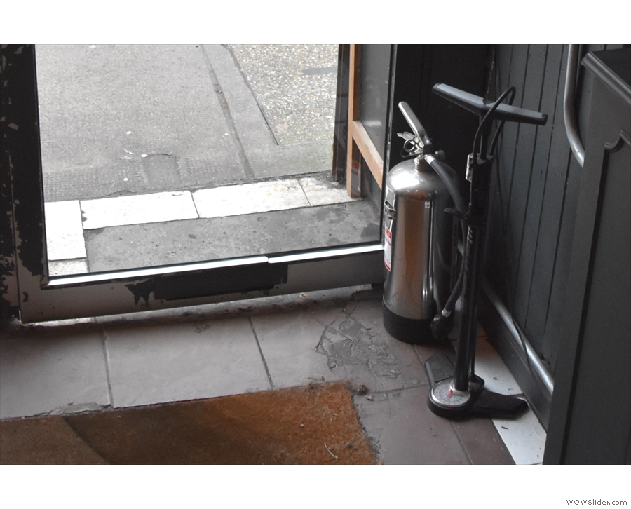 Another nice touch is this bicycle pump by the door which customers are free to use.