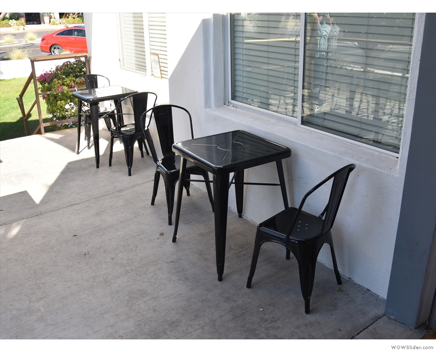 The bulk of the seating is out on the patio, with a pair of tables against the east wall...