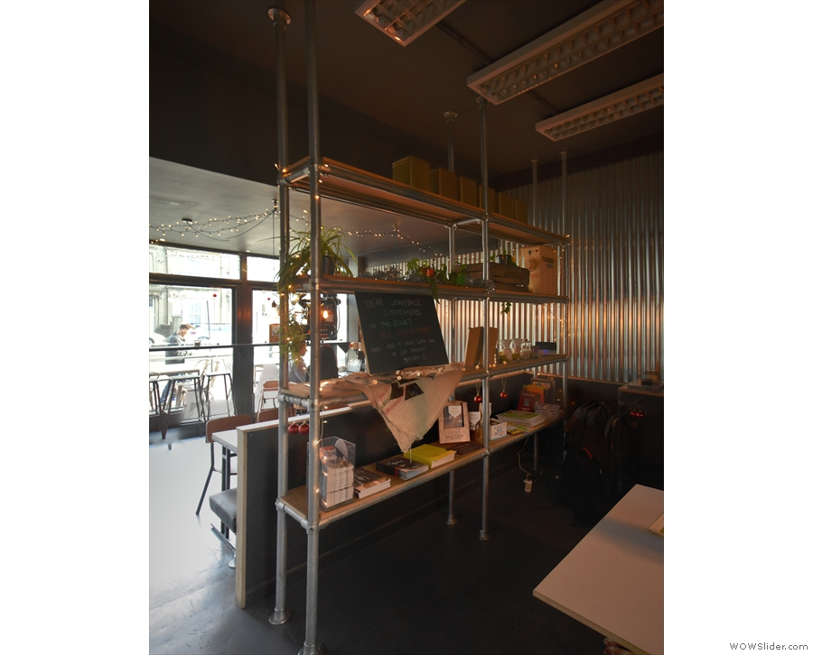A set of shelves separates the rear of the Workspace from the front...