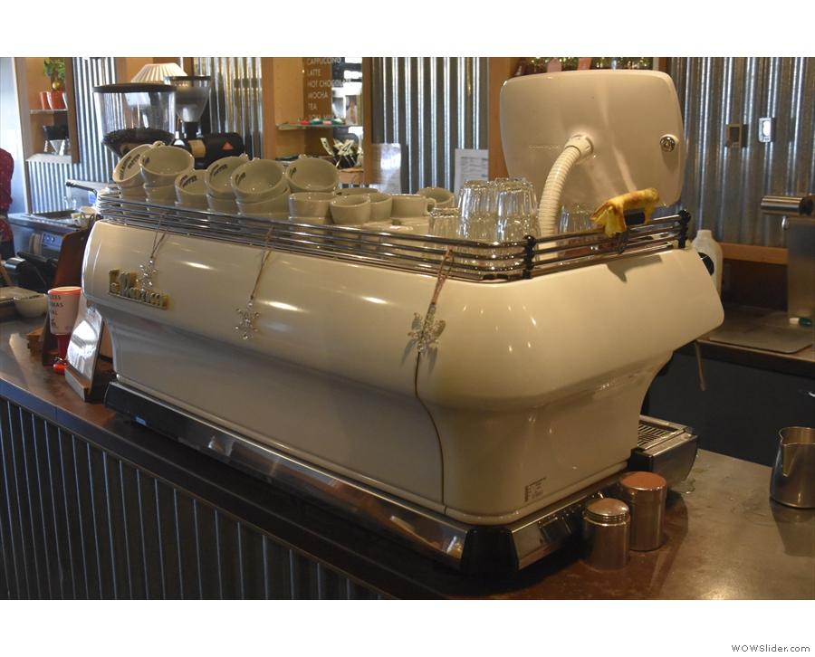 The white La Marzocco FB 80 espresso machine is at the far end of the counter.