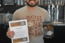 ... and to present Peixoto with its Coffee Spot Award Certificate!