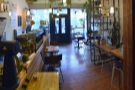 The view of the front half of Machina Espresso from towards the back of the counter.