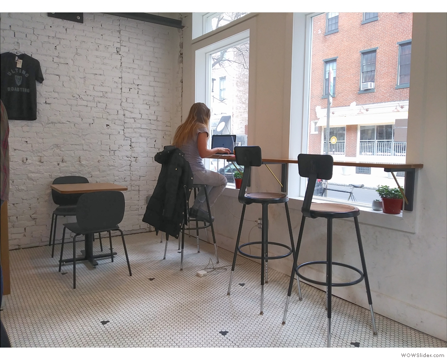 ... window-bar. There's also a two-person table up against the wall.