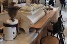 ... which is right in front of the espresso machine, a white La Marzocco Strada.
