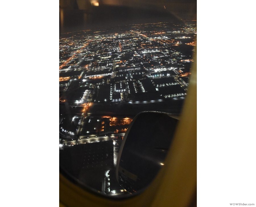 The lights of O'Hare quickly dropped away below us as we climbed...