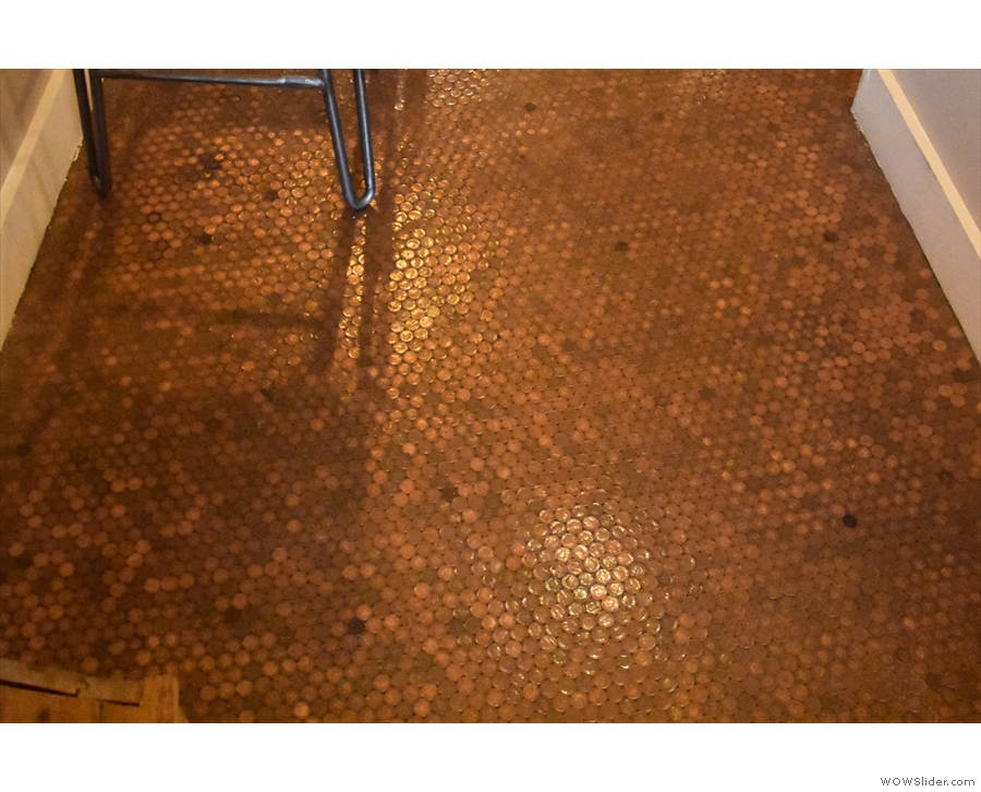 It also pays to look down. The floor of the back room is decorated by 20,000 pennies!