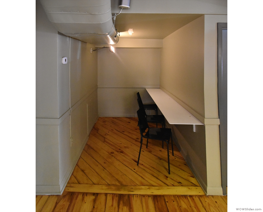 .. this windowless alcove has a three-person bar against the walll.