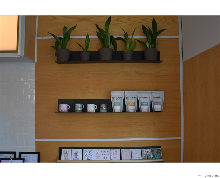 Meanwhile, there are more plants (and cards) on the shelves at the front, along with...