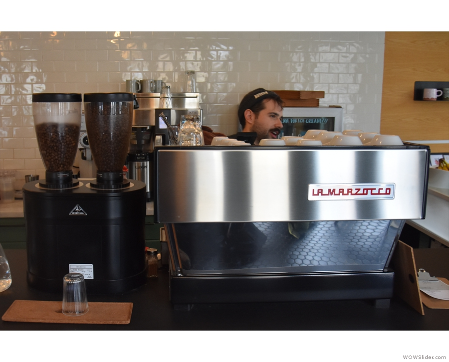 The espresso machine, and its twin-headed grinder, are off to the left.