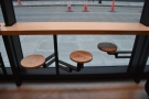 Seating is provded by these fold-out stools, three per window...