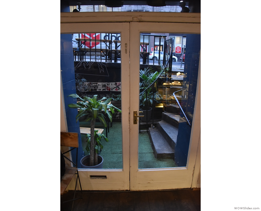 The glass double doors, as seen from the inside of Cairngorm Coffee.