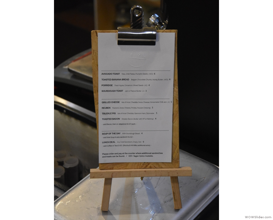 There's another, more detailed, food menu to the right of the till.