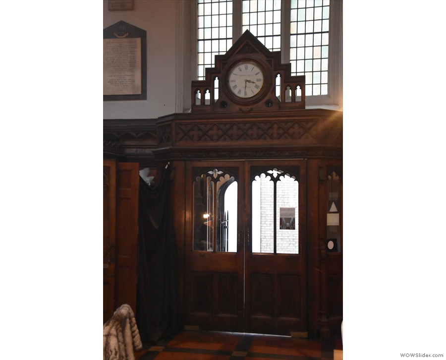 This is the door on that side, with a neat clock above it.