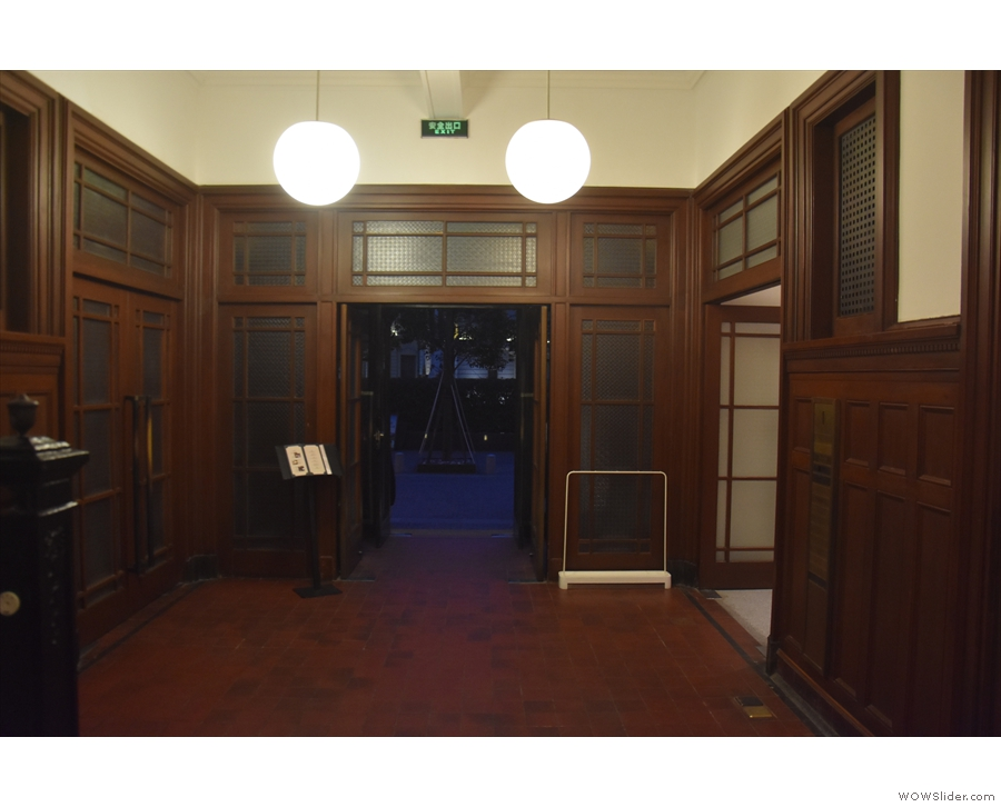 The entrance, seen here from the inside, leads into this lovely, wood-panelled corridor...