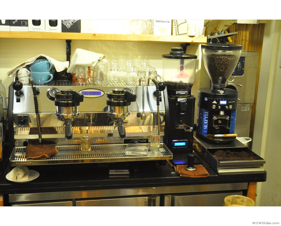 The epresso machine and its two grinders, seen here in 2016, are behind the coounter.