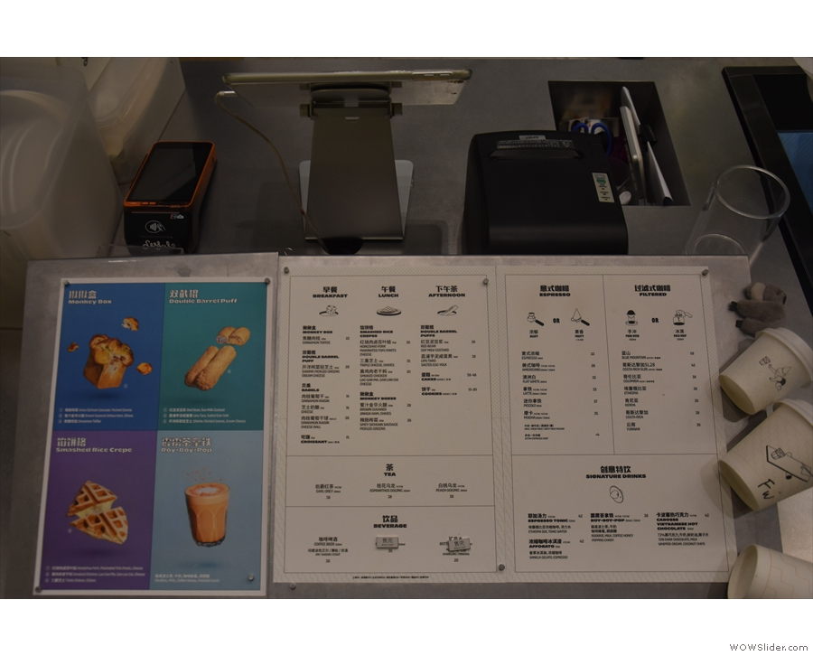There's a comprehensive food and drink menu by the till...