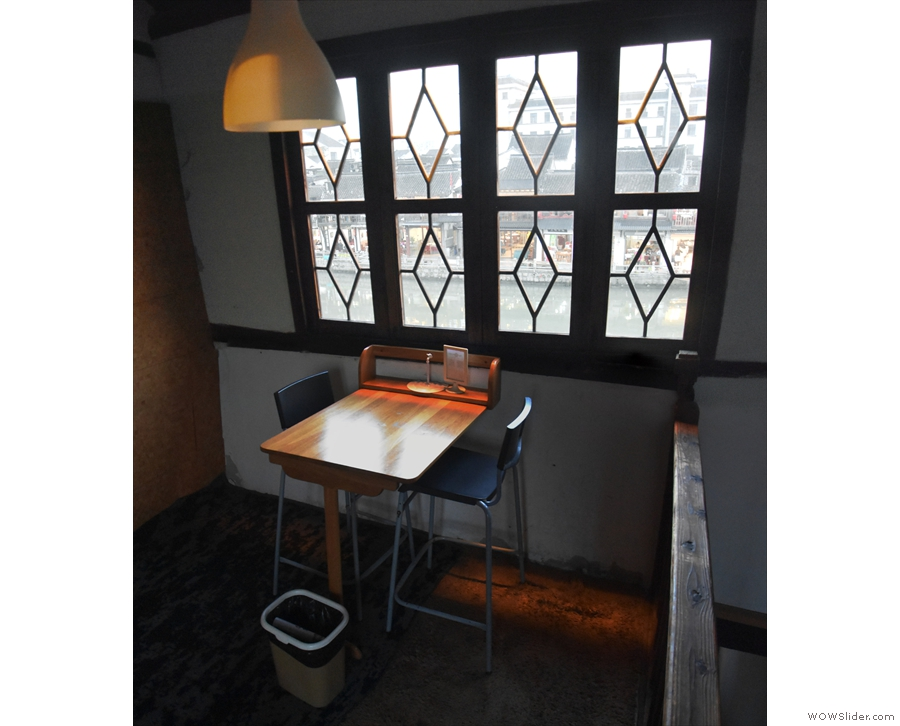 On the top floor, the back room is smaller, with just this two-person table...