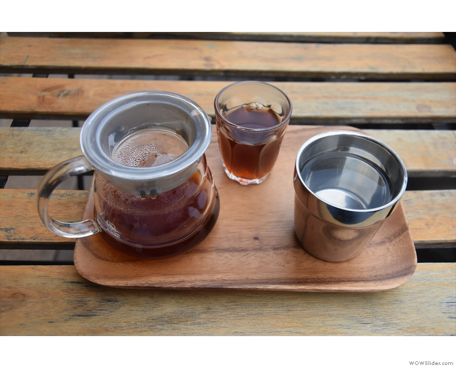 My coffee, in a carafe, glass at the side, is beautifully presented on a tray, brought out...