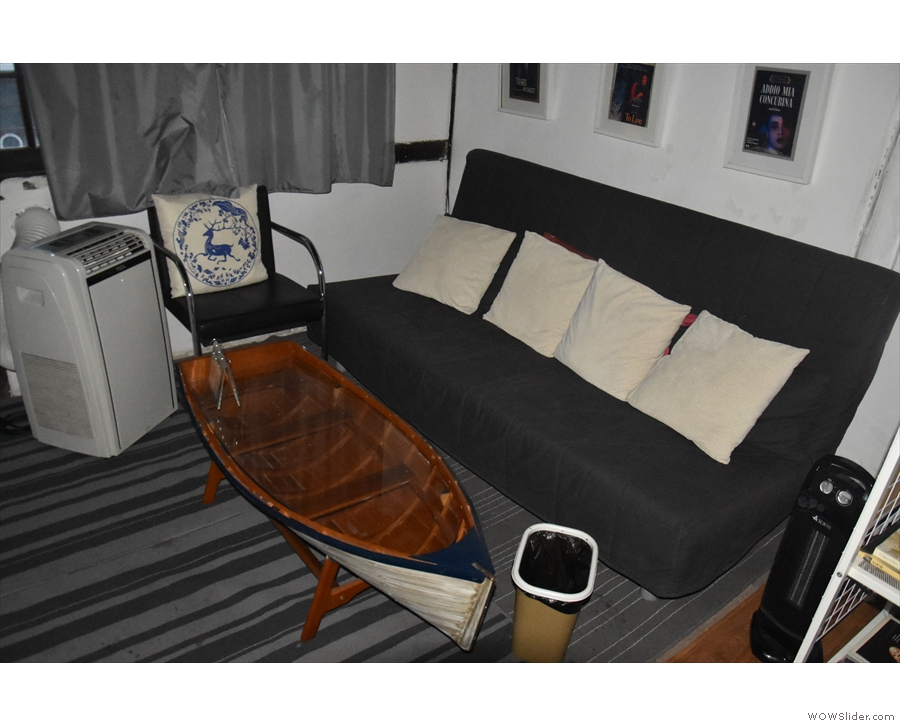 ... while at the front, there's a larger sofa and a boat-shaped coffee table.