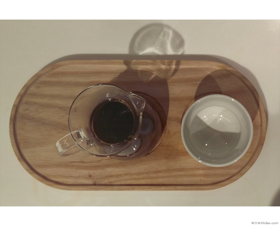 .. beautifully-presented on a wooden tray with a cup on the side.